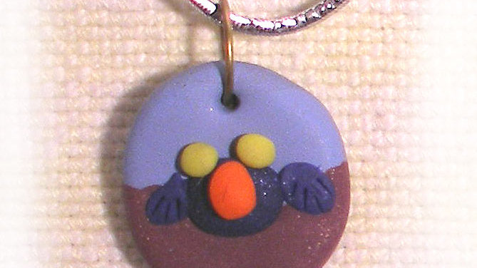 Funny-face on string necklace