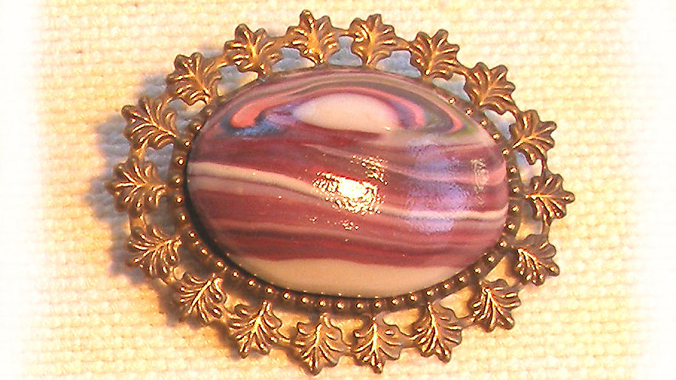 Purple marble on metal plate