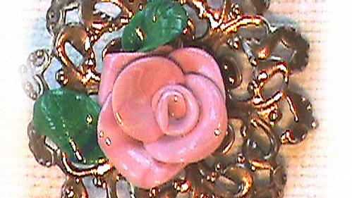 Pink rose on metal plate