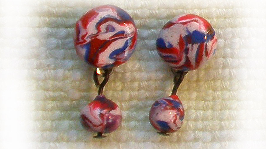 Blue-white-red marble with drops