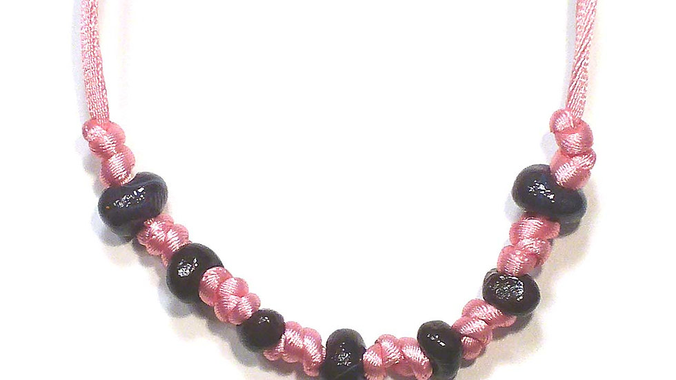Brown beads on pink string necklace