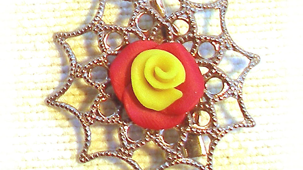 Yellow-red rose on metal plate
