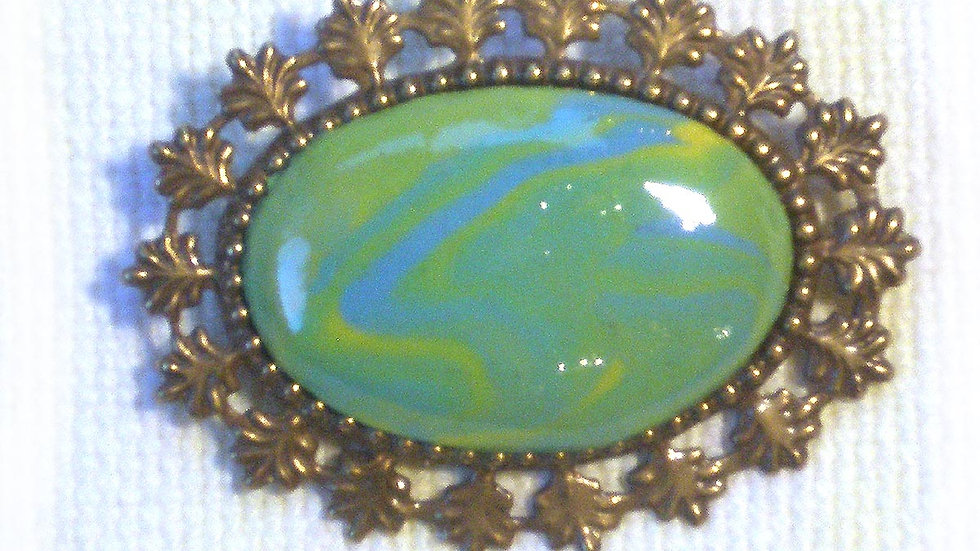 Green marble on metal plate