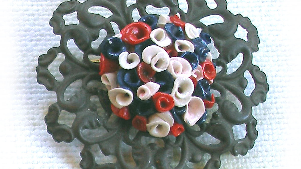 Blue-white-red flowers on metal plate