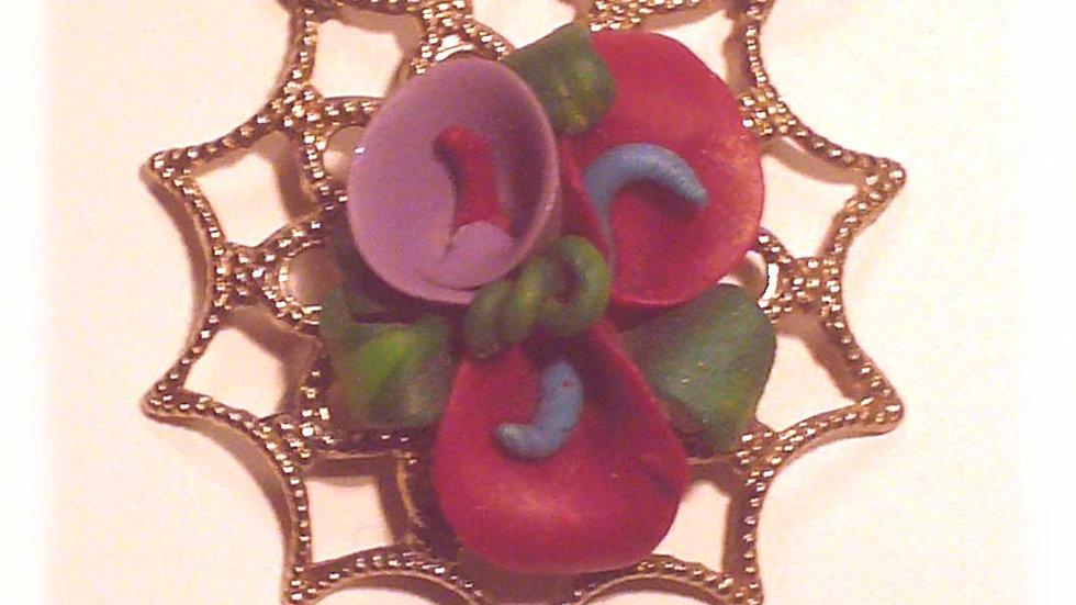Flowers on metal pendent