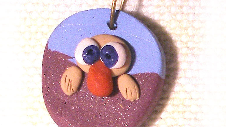 Funny face on string necklac