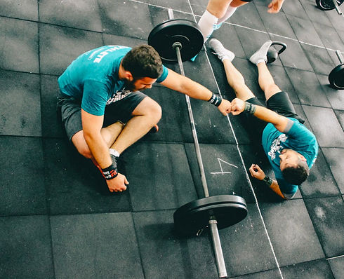 Personal trainer working with client in a gym in San Francisco, CA