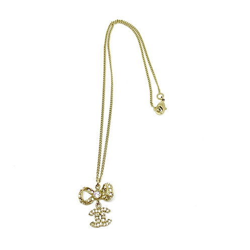 CHANEL Gold CC Logo Rhinestone Ribbon Bow Pendant