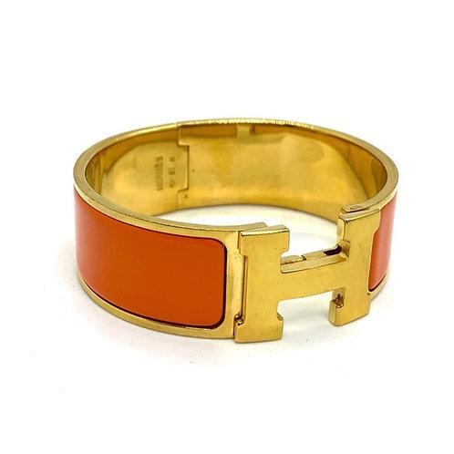 "HERMES Wide PM Clic Clac Bracelet in ""Hermes"" Orange Gold Hardware"