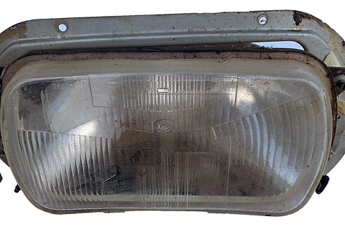 HC headlight including surround