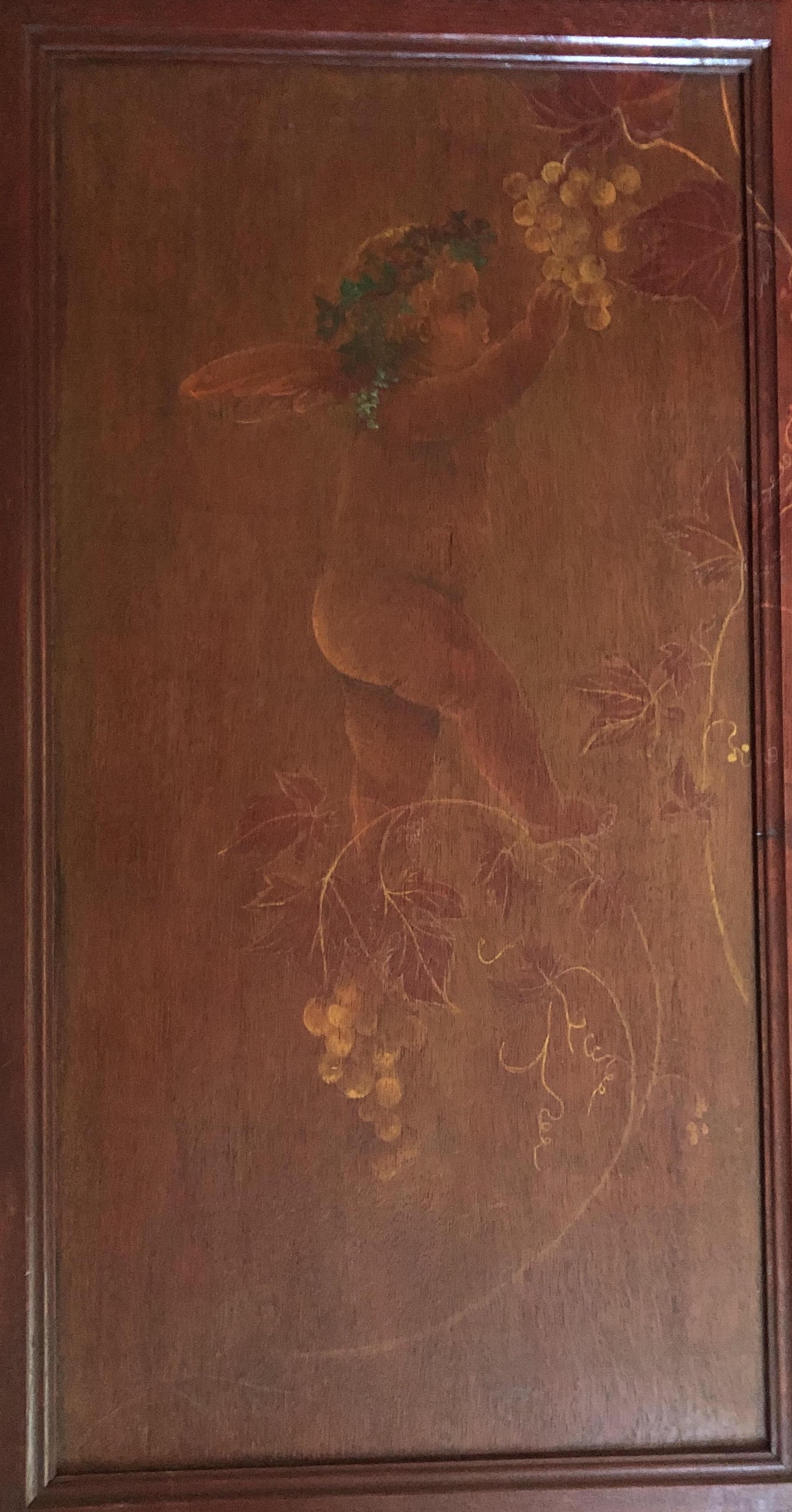 Angelot cueillant du raisin