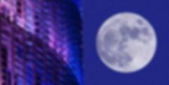 La Luna llena y la torre Agbar