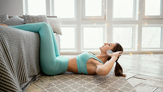 woman-exercising-mat-listening-music.jpg