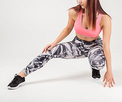 front-view-athletic-woman-stretching-her