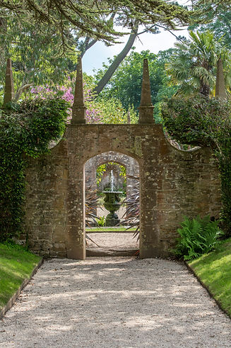Entrance to the Corona Garden at Athelhampton House that has amazing gardens to visit. a great visitor attraction in Dorset