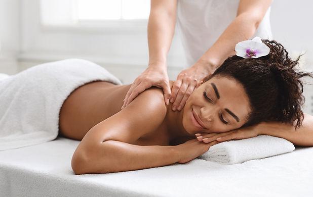 Relaxed black girl enjoying full body ma