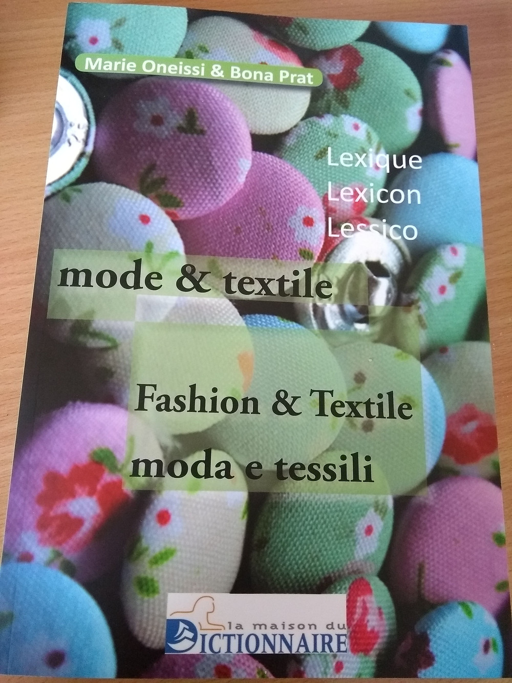 My copy of the Trilingual Glossary of Fashion & Textile dictionary