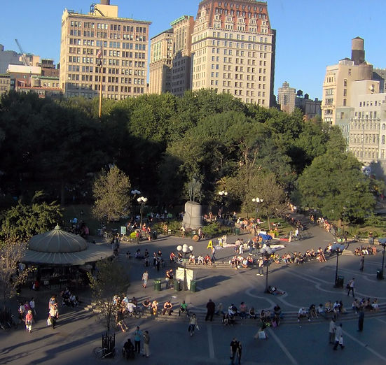Union Square Park in New York on a busy sunny day, with people milling around.