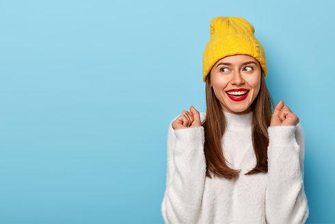happy-brunette-woman-raises-clenched-fis