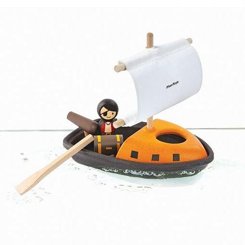 Piratski čoln z gusarjem ali gusarko