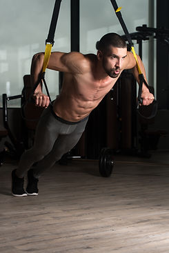 Attractive Man Does Crossfit With Trx Fi