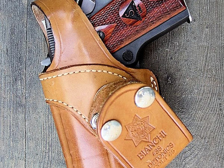 Striker pistols are incompatible with 'modern' holsters
