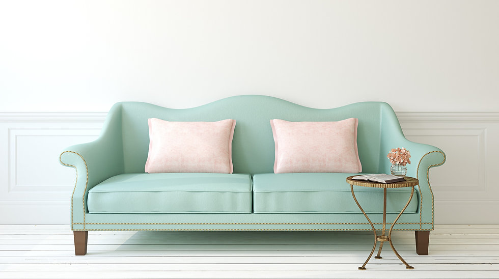 blue sofa with two white cushions