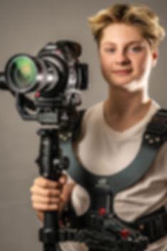 Headshot with gear (close up).jpg