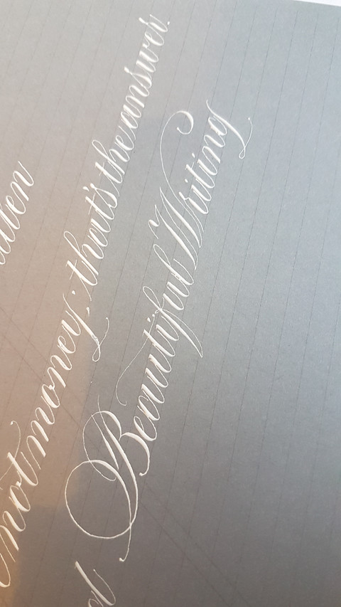 Grey paper and white ink