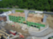 Drone image of five-story hotel under construction with engineering my Apex Engineers