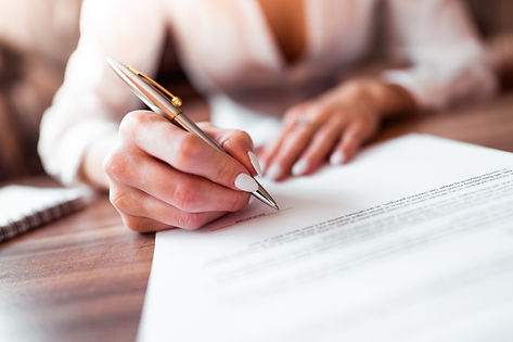 business-woman-signing-a-contract-picjum