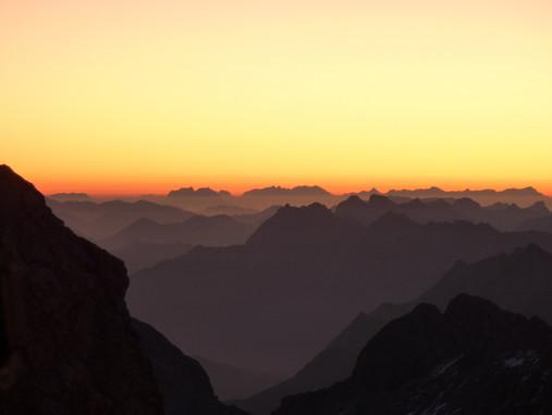Canva - Silhouette of Hills Under Orange