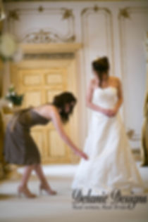 bridesmaid fixes brides' gown