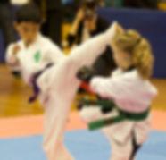Karate student kicking