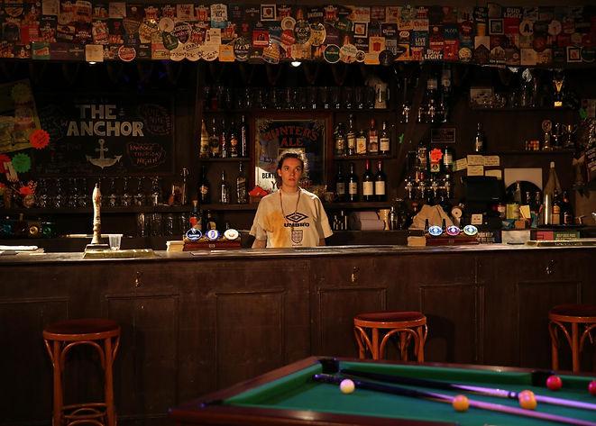 LUCY BROMILOW behind bar .jpg