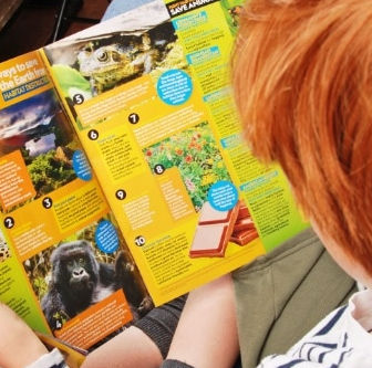 A child reading National Geographic Kids Magazine.