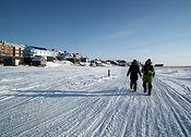 6832448-Swiss-photographers-walking-on-t