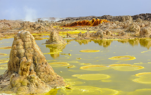 Witness the volcanic salt deposits of Dallol