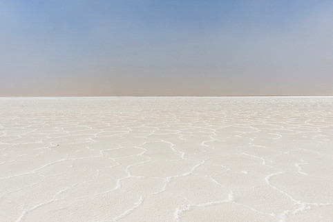 Marvel at the salt lakes of the Danakil Depression and learn about the salt mining trade