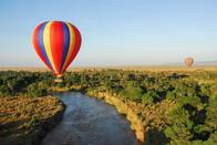 Hotair balloon safari admiring the vast open plains of the Maasai Mara