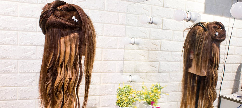 clip on hair extension attached to a mannequin training head, flowers, mirror, human hair clip on hair extensions