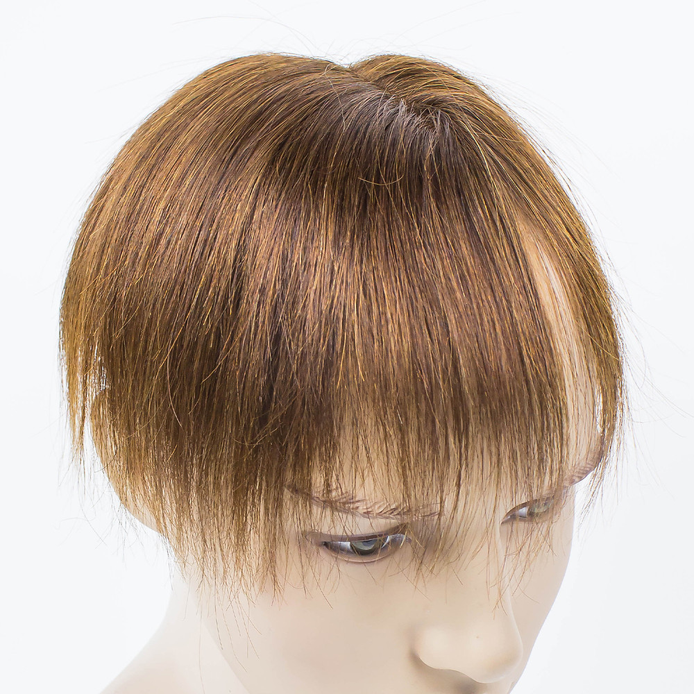 brown human hair toupee in a male mannequin head