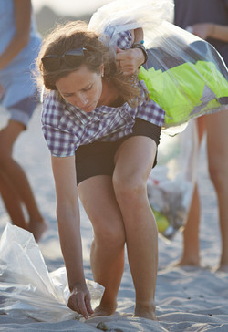 Collecting Trash on Beach