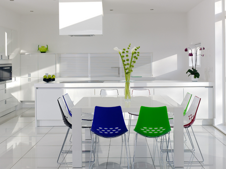 A white interior with contrasting dining room chairs