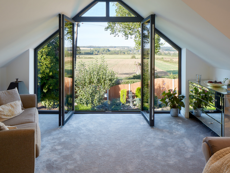 First floor feature window with a seamless glass balustrade