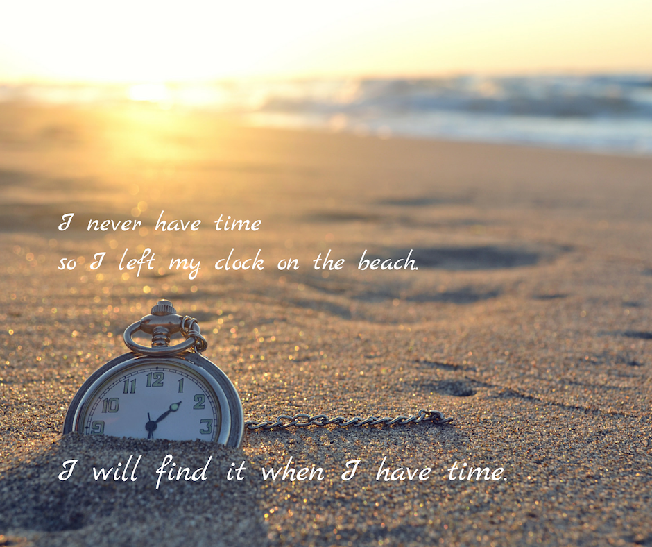 Clock in the sand on a beach