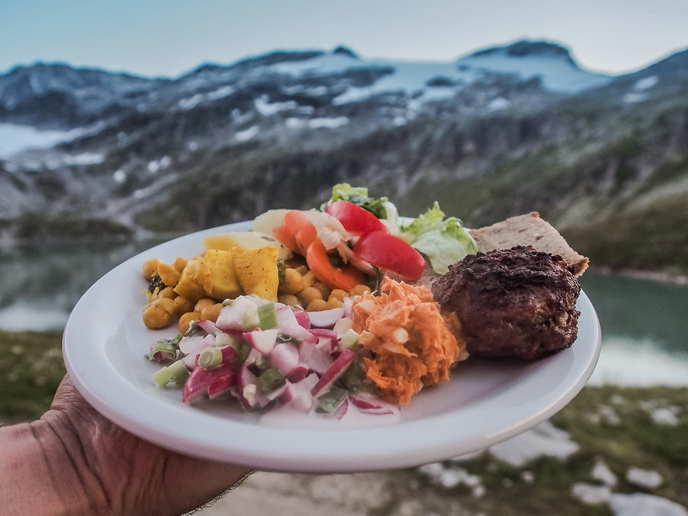 Healthy food on a plate with mountains in the background