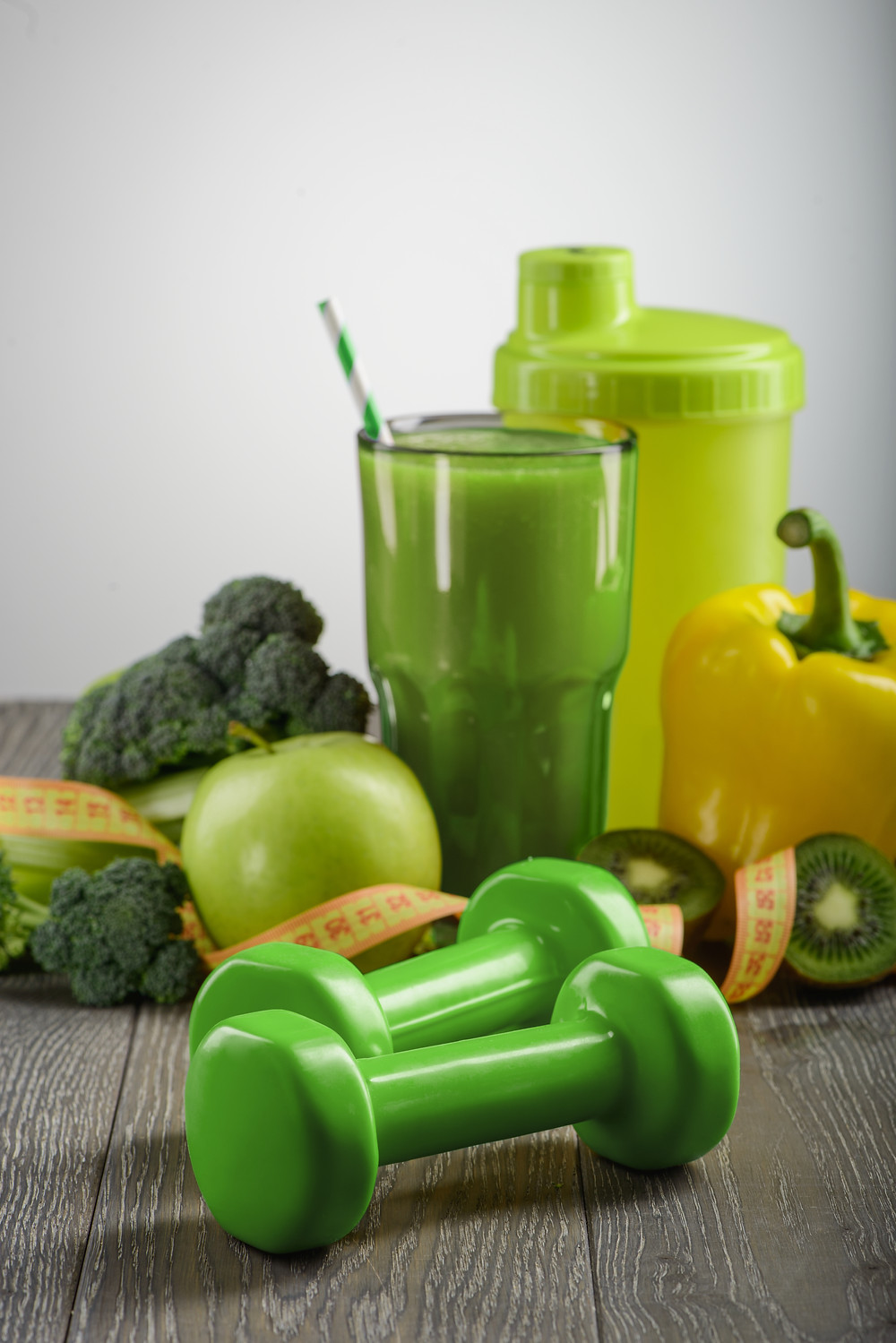 Weights and healthy food as a healthy habit.