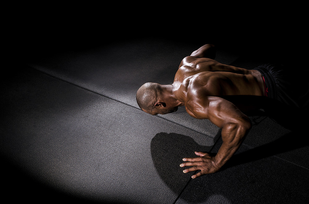 Muscle man doing a push up.