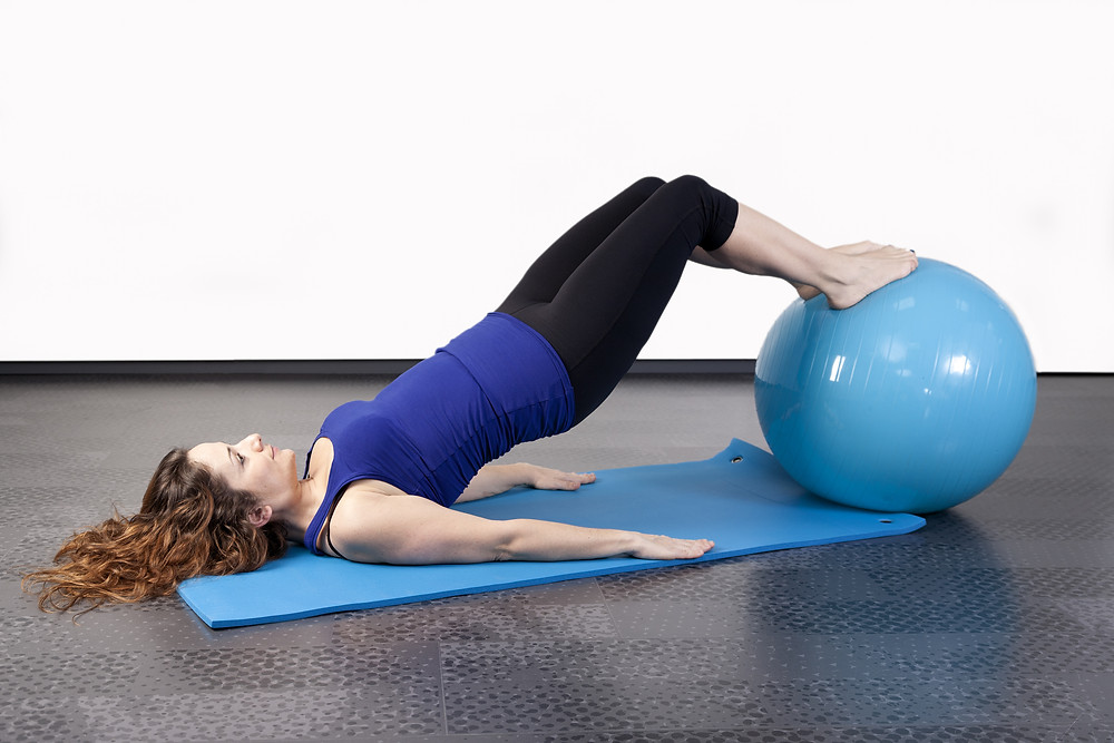 Woman doing fitness on a stability ball